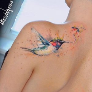 Exquisite watercolor styled Tattoo